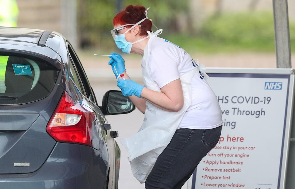 Photo taken at 9.54am shows tests being carried out at a coronavirus testing site in a car park at Chessington World of Adventures, in Greater London, as the UK continues in lockdown to help curb the spread of the coronavirus. (Photo by Jonathan Brady/PA Images via Getty Images)