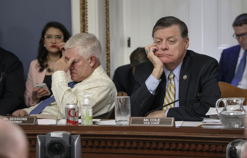 <p> After eight hours of debate, House Rules Committee Chairman Rep. Pete Sessions, R-Texas, left, and Rep. Tom Cole, R-Okla., the vice-chair, listen to arguments from committee chairs as the panel meets to shape the final version of the Republican health care bill before it goes to the floor for debate and a vote, Wednesday, March 22, 2017, on Capitol Hill in Washington. (AP Photo/J. Scott Applewhite) </p>