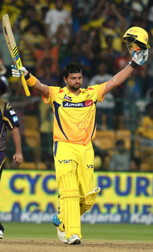 Chennai Super Kings player Suresh Raina celebrates his century during the final CLT20 match between Kolkata Knight Riders and Chennai Super Kings at M.Chinnaswamy Stadium in Bangalore, on Oct.4, 2014. (Photo: IANS)