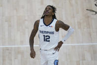 Memphis Grizzlies guard Ja Morant looks at the scoreboard as he walks upcourt during the second half of Game 5 of the team's NBA basketball first-round playoff series against the Utah Jazz on Wednesday, June 2, 2021, in Salt Lake City. (AP Photo/Rick Bowmer)