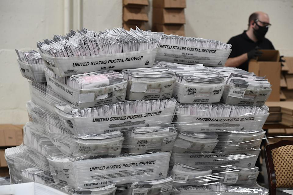 Mail-in ballots in their envelopes await processing at the Los Angeles County Registrar Recorders' mail-in ballot processing center at the Pomona Fairplex in Pomona, California, Oct. 28, 2020. (Photo: ROBYN BECK/AFP via Getty Images)