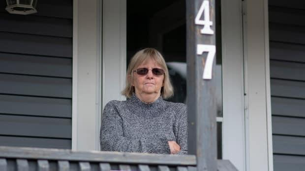 Patricia Atkinson, 58, has lived in the same two-storey house in Hamilton's Keith neighbourhood for 25 years and suffers from epilepsy and severe back problems. She receives Ontario disability support program (ODSP) payments that were cut back when her daughter bought her home. (Bobby Hristova/CBC - image credit)