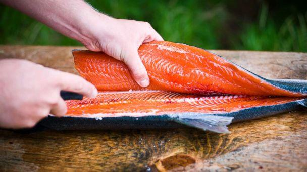 PHOTO: A person fillets a freshly caught wild salmon in an undated stock photo. (STOCK PHOTO/Getty Images)