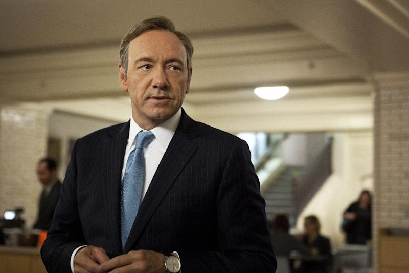 """This image released by Netflix shows Kevin Spacey as U.S. Congressman Frank Underwood in a scene from the Netflix original series, """"House of Cards."""" Spacey was nominated for an Emmy Award for best actor in a drama series on, Thursday July 18, 2013. The Academy of Television Arts & Sciences' Emmy ceremony will be hosted by Neil Patrick Harris. It will air Sept. 22 on CBS. (AP Photo/Netflix, Melinda Sue Gordon)"""