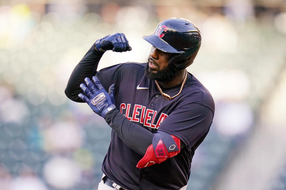 Cleveland Indians' Franmil Reyes shows off his muscle as he rounds the bases on his solo home run against the Seattle Mariners in the second inning of a baseball game Thursday, May 13, 2021, in Seattle. (AP Photo/Elaine Thompson)