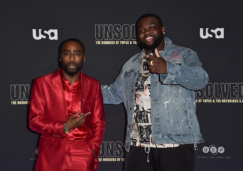 """Actors Marcc Rose (L) and Wavyy Jonez attend the premiere of """"Unsolved: The Murders of Tupac and The Notorious B.I.G."""" on February 22, 2018 in Hollywood, California (AFP Photo/Alberto E. Rodriguez)"""