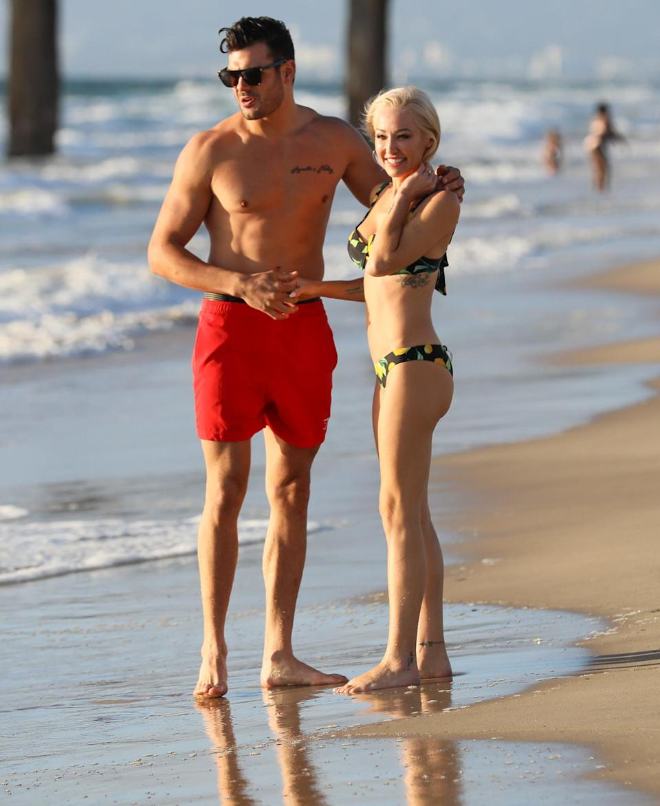 <p><em>Selling Sunset</em> stars Mary Fitzgerald and Romain Bonnet cozy up on the beach in L.A. on Sunday.</p>