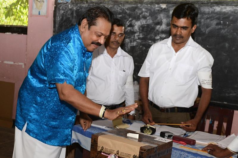 When Sri Lanka's former strongman Mahinda Rajapakse cast his ballot on Monday, he expressed confidence that he could return to power as Sri Lanka's prime minister (AFP Photo/Lakruwan Wanniarachchi)