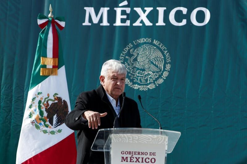 Mexican president vows justice in visit to town scarred by massacre