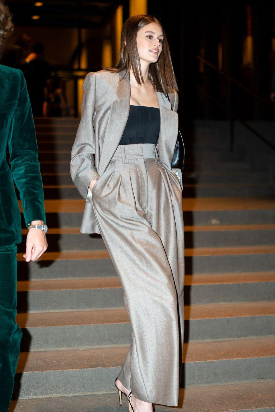 <p>Forget the floral maxi, an '80s power suit is a showstopping alternative wedding guest outfit, ideal for an evening reception in the city and worn masterfully by Kaia Gerber, of course, as she attended Marc Jacobs' big day.</p>