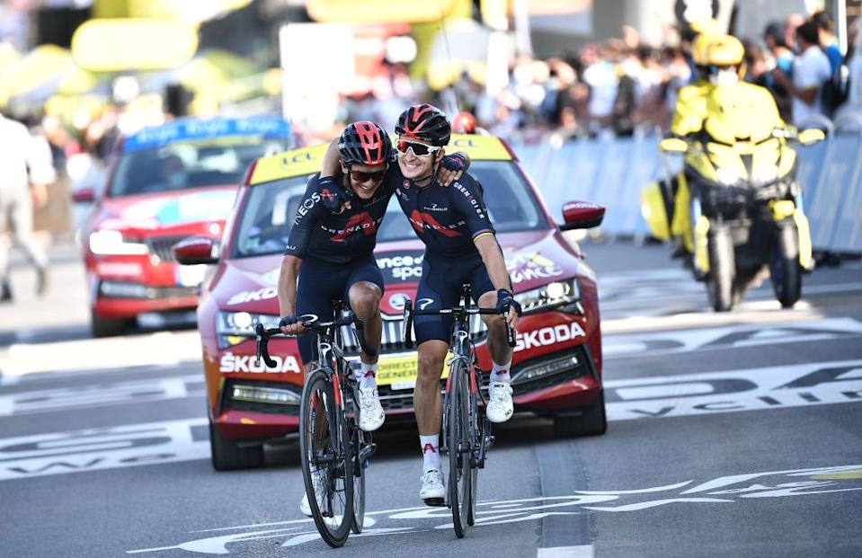 Team Ineos rider Polands Michal Kwiatkowski R celebrates as he crosses the finish line ahead of Team Ineos rider Ecuadors Richard Carapaz during the 18th stage of the 107th edition of the Tour de France cycling race 168 km between Meribel and La Roche sur Foron on September 17 2020 Photo by AnneChristine POUJOULAT  POOL  AFP Photo by ANNECHRISTINE POUJOULATPOOLAFP via Getty Images