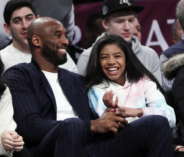 Kobe Bryant and his daughter Gigi, watch an NBA basketball game between the Brooklyn Nets and Atlanta Hawks on December 21, 2019 at Barclays Center in New York City. (Photo by Paul Bereswill/Getty Images)