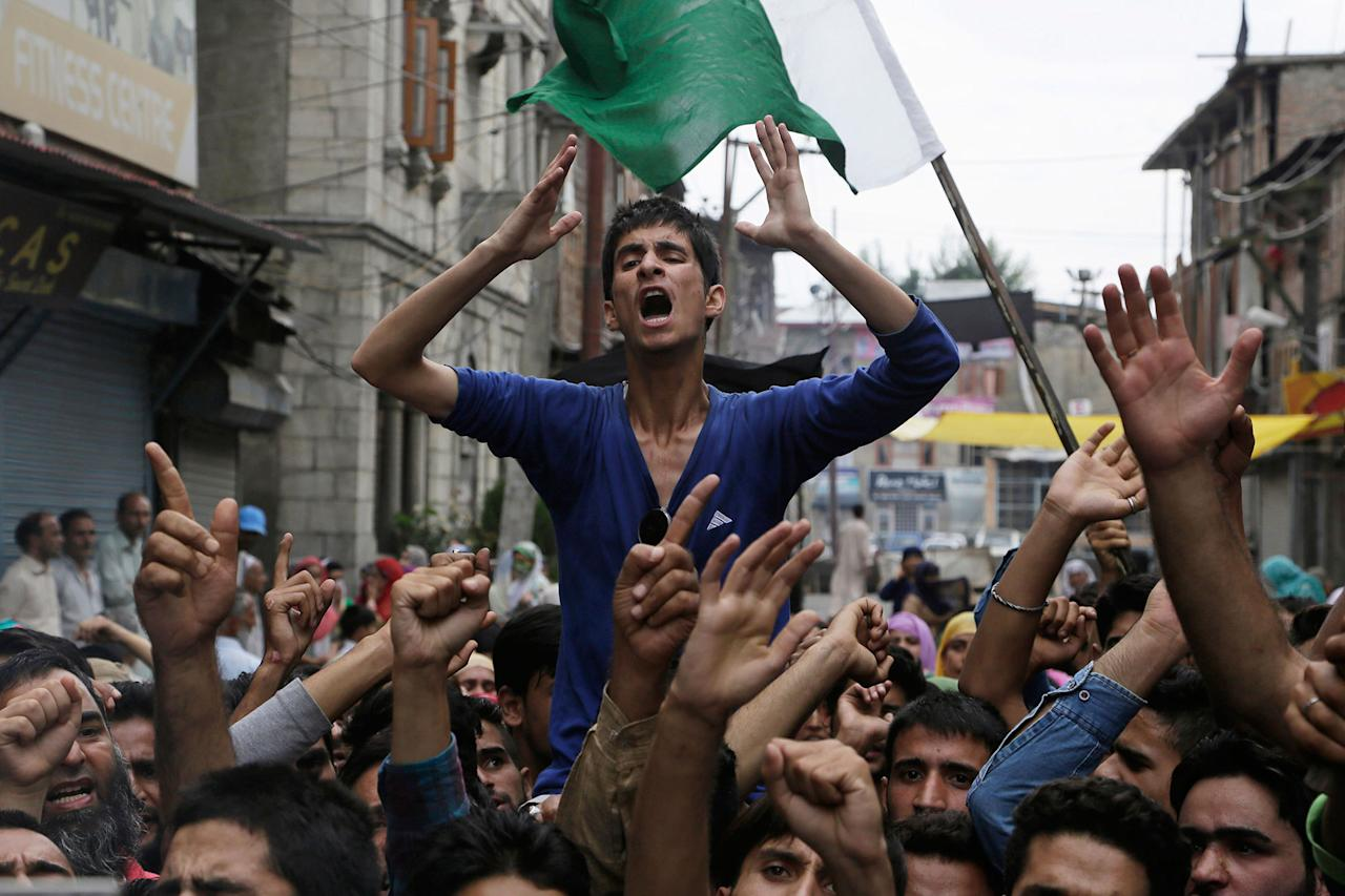 <p>Neighbors and relatives of Irfan Ahmed Wani, who died late Sunday after being hit by a tear gas shell, shout anti-India slogans as they protest his death in Srinagar, Indian-controlled Kashmir, Monday, Aug. 22, 2016. Security lockdown and protests continued with tens of thousands of Indian armed police and paramilitary soldiers patrolling the tense region after the killing of a popular rebel commander on July 8 sparked some of Kashmir's largest protests against Indian rule in recent years. (AP Photo/Mukhtar Khan) </p>