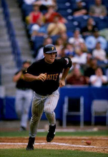 """<p><strong>April 24, 1998</strong>: Pittsburgh's Jason Kendall is on third base in the sixth inning. When Turner Ward slaps a grounder wide of first, the Padres' Mark Sweeney fields it and Kendall races home. Sweeney's throw to catcher Carlos Hernandez has Kendall beat easily, but it's way off line. The Pirates catcher dives up the third base line and flies into home plate. Safe! """"Part slide, part leap, part airborne flight, part acrobatic moment,"""" says Frommer. """"Kendall's feat is just all fabulous.""""<br> </p>"""