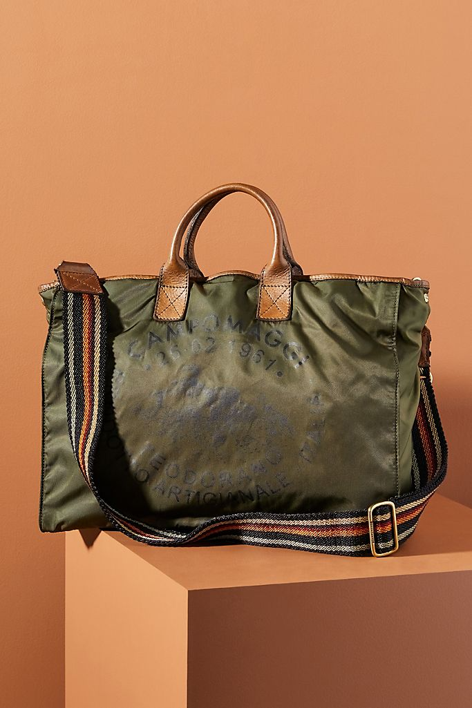 """<h2><a href=""""https://www.anthropologie.com/shop/campomaggi-nylon-tote-bag"""" rel=""""nofollow noopener"""" target=""""_blank"""" data-ylk=""""slk:Campomaggi Nylon Tote"""" class=""""link rapid-noclick-resp"""">Campomaggi Nylon Tote</a></h2><br>This meticulously crafted tote is made of nylon with buttery leather handles and vintage-inspired details. <br><br><strong>Campomaggi</strong> Nylon Tote Bag, $, available at <a href=""""https://go.skimresources.com/?id=30283X879131&url=https%3A%2F%2Fwww.anthropologie.com%2Fshop%2Fcampomaggi-nylon-tote-bag"""" rel=""""nofollow noopener"""" target=""""_blank"""" data-ylk=""""slk:Anthropologie"""" class=""""link rapid-noclick-resp"""">Anthropologie</a>"""