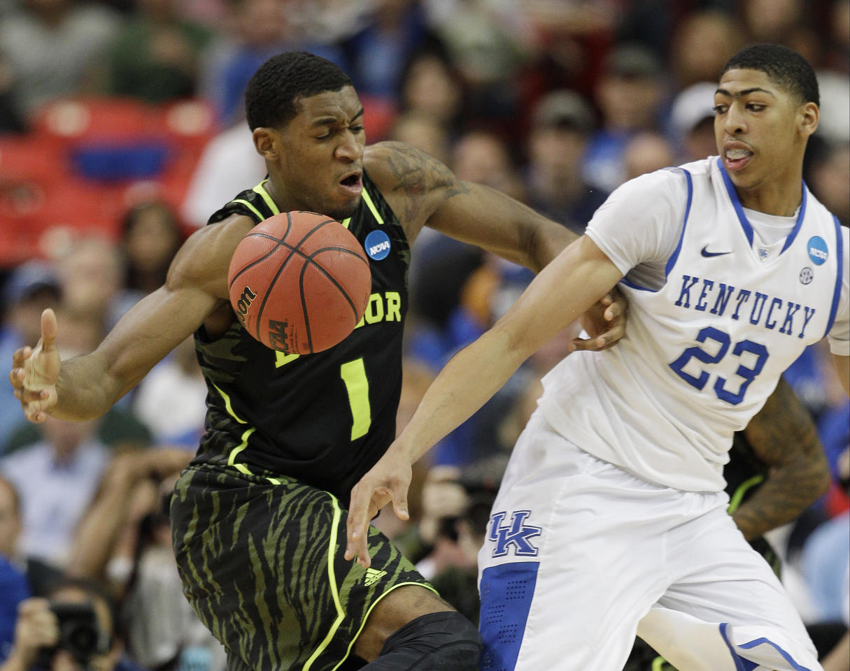 Baylor's Perry Jones III (1) and Kentucky's Anthony Davis (23) vie for a lose ball during the first half of an NCAA tournament South Regional finals college basketball game Sunday, March 25, 2012, in Atlanta. (AP Photo/David J. Phillip)