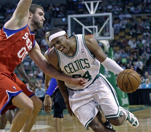 Boston Celtics' Paul Pierce, right, tries to drive past Philadelphia 76ers defender Spencer Hawes, left, during the first quarter of Game 5 in their NBA basketball Eastern Conference semifinal playoff series in Boston, Monday, May 21, 2012. (AP Photo/Charles Krupa)