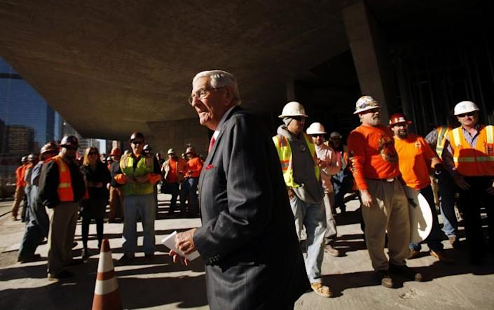 LOS ANGELES, CA - JANUARY 08, 2013: Philanthropist Eli Broad is surrounded by union construction workers as officials attended the topping-out ceremony commemorating the placement of the steel beams in the framing of The Broad Museum located at the corner of Grand Avenue and Second Street in downtown Los Angeles on January 08, 2013. (Al Seib / Los Angeles Times)