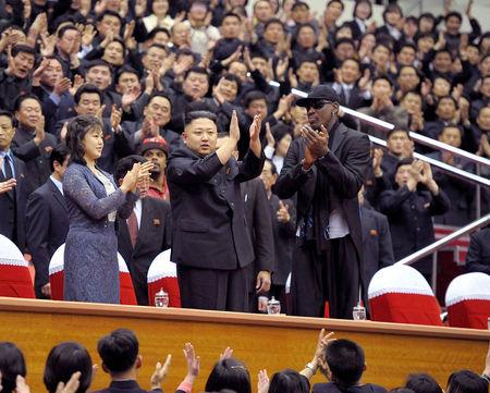 FILE PHOTO: North Korean leader Kim Jong-Un (C), his wife Ri Sol-Ju (L) and former NBA basketball player Dennis Rodman clap during an exhibition basketball game in Pyongyang in this undated picture released by North Korea's KCNA news agency on March 1, 2013.  REUTERS/KCNA/File photo