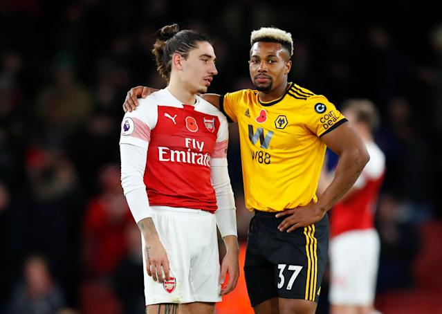 """Soccer Football - Premier League - Arsenal v Wolverhampton Wanderers - Emirates Stadium, London, Britain - November 11, 2018 Arsenal's Hector Bellerin and Wolverhampton Wanderers' Adama Traore after the match REUTERS/Eddie Keogh EDITORIAL USE ONLY. No use with unauthorized audio, video, data, fixture lists, club/league logos or """"live"""" services. Online in-match use limited to 75 images, no video emulation. No use in betting, games or single club/league/player publications. Please contact your account representative for further details."""