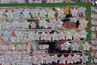 A woman hangs on a paper note to wish for her child's success in the college entrance exams at the Jogyesa Buddhist temple in Seoul, South Korea, Thursday, Dec. 3, 2020. Hundreds of thousands of masked students in South Korea, including 35 confirmed COVID-19 patients, took the highly competitive university entrance exam Thursday despite a viral resurgence that forced authorities to toughen social distancing rules. (AP Photo/Ahn Young-joon)