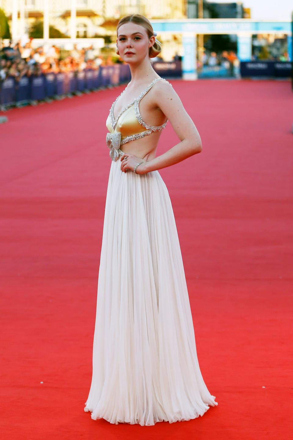 <p>Elle Fanning kick-started this month's fashionable proceedings at the 44th Deauville American Film Festival in France in a bespoke Miu Miu gown. She accessorised the ethereal gown with regal buns wrapped up in satin bows and Tiffany & Co. jewels. <em>[Photo: Getty]</em> </p>