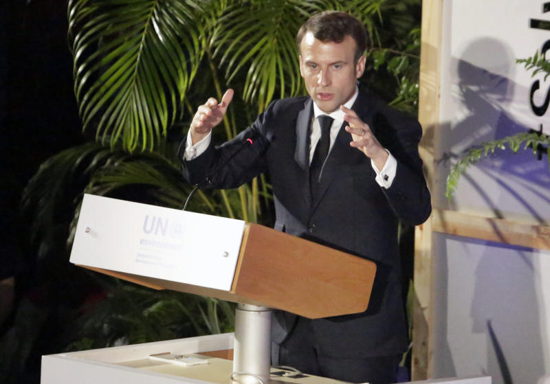 France's President Emmanuel Macron addresses delegates at the United Nations Environment Assembly in Nairobi, Kenya Thursday, March 14, 2019. Macron said at the conference Thursday that energy resources like coal that fueled industrialization in the developed world are no longer viable because they create pollution. (AP Photo/Khalil Senosi)
