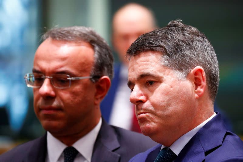 FILE PHOTO: Irish Finance Minister Paschal Donohoe (R) and Greek Finance Minister Christos Staikouras attend a Euro zone finance ministers meeting in Brussels