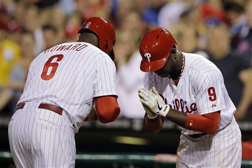 Philadelphia Phillies' Ryan Howard (6) celebrates his home run with teammate Domonic Brown (9) during the fourth inning of a baseball game against the Pittsburgh Pirates, Wednesday, April 24, 2013, in Philadelphia. (AP Photo/Matt Slocum)