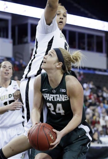 Michigan State forward Courtney Schiffauer (24) looks to the basket as Purdue forward Taylor Manuel (5) defends during the first half of an NCAA college basketball game in the Big Ten Conference tournament in Hoffman Estates, Ill., on Sunday, March 10, 2013. (AP Photo/Nam Y. Huh)