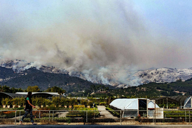 <p>A girl walks past a nursery just south of Carpinteria High School on HWY 192 (Photo: Santa Barbara News-Press via ZUMA Wire) </p>