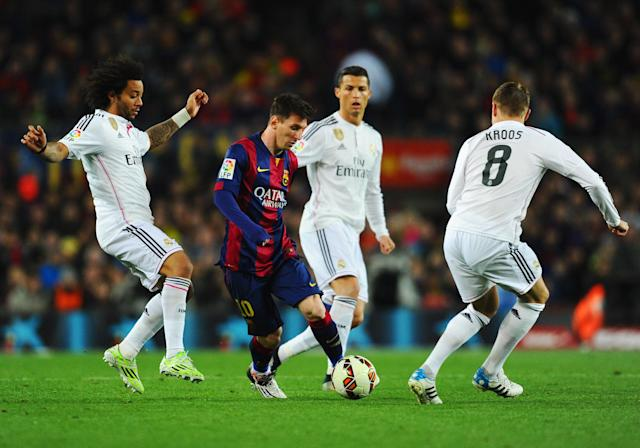 Lionel Messi evades Real Madrid defenders in one of many Clasicos past. (Getty)