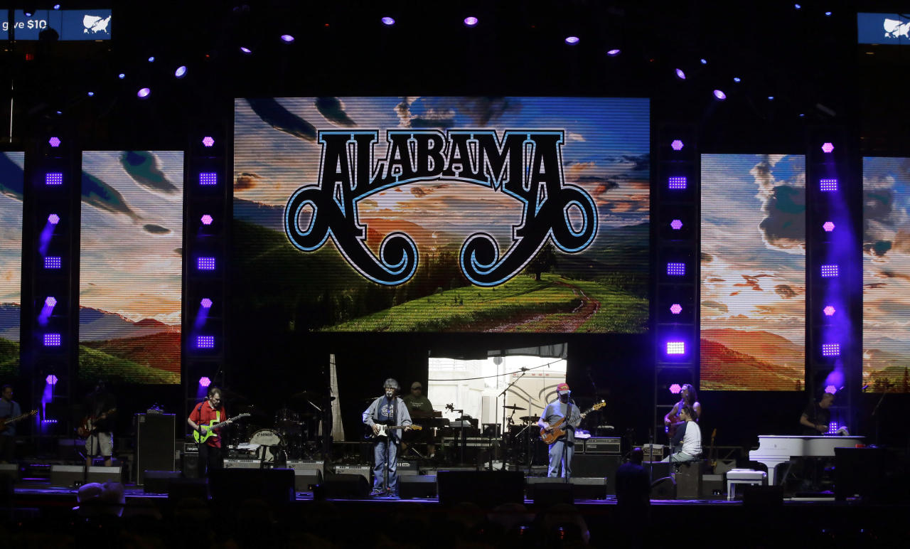 A sound check is conducted before a concert in College Station, Texas, Saturday, Oct. 21, 2017. All five living former U.S. presidents will be attending the concert Saturday night, raising money for relief efforts from hurricane devastation in Texas, Florida, Puerto Rico and the U.S. Virgin Islands. (AP Photo/LM Otero)