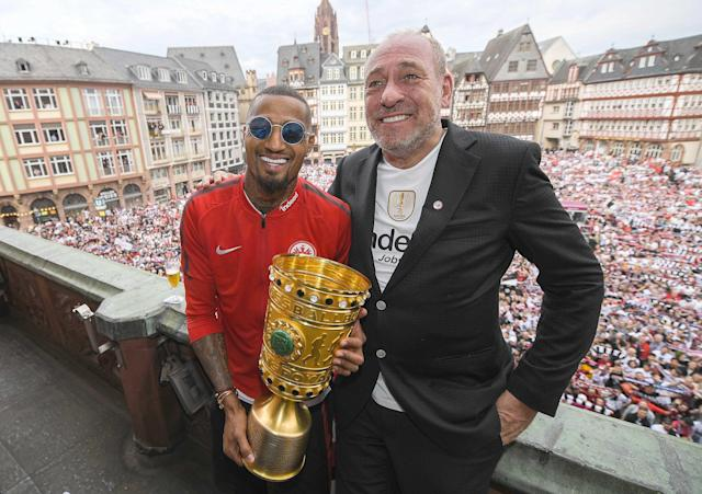 Soccer Football - Eintracht Frankfurt DFB Cup Trophy Presentation - Roemer, Frankfurt, Germany - May 20, 2018. Eintracht Frankfurt's Kevin-Prince Boateng and President Peter Fischer celebrate with the DFB Cup trophy during the presentation. Andreas Arnold/Pool via Reuters