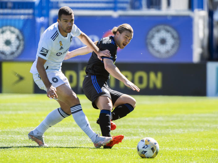 CF Montreal's Samuel Piette, right, challenges Chicago Fire FC's Luka Stojanovic during first half MLS soccer action in Montreal, Sunday, Sept. 19, 2021. (Graham Hughes/The Canadian Press via AP)