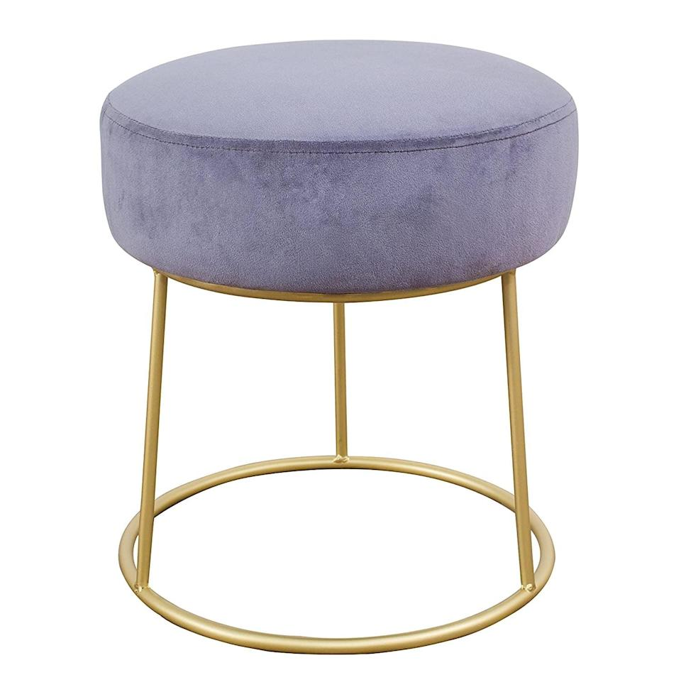 <p>This <span>TOV Furniture The Nina Collection Modern Velvet Upholstered Round Backless Short Stool</span> ($53) will add a touch of glam to your living room.</p>