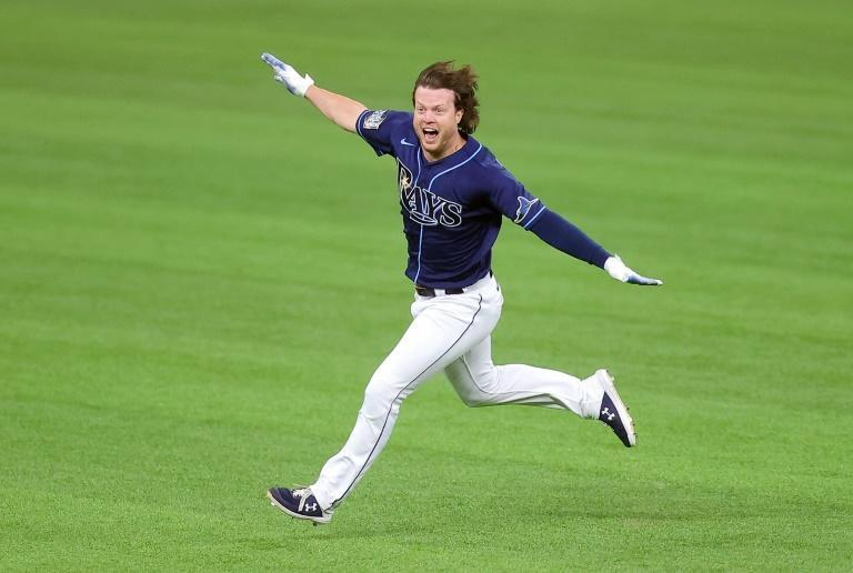 Brett Phillips celebrates after hitting a ninth-inning two-run walkoff single in the Tampa Bay Rays 8-7 victory over the Los Angeles dodgers that evened the World Series at two games apiece