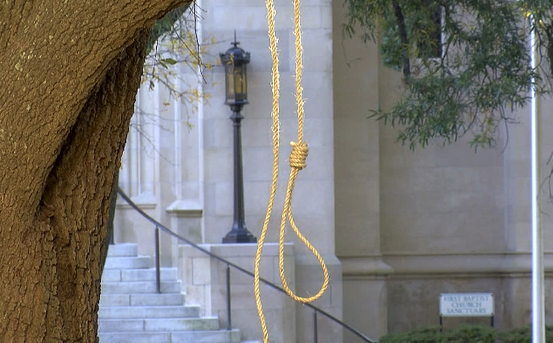 A noose hangs on a tree on the state Capitol grounds in Jackson, Miss., on Monday. A Mississippi official says two nooses and six signs were found on Capitol grounds. (Photo: WLBT-TV via AP)