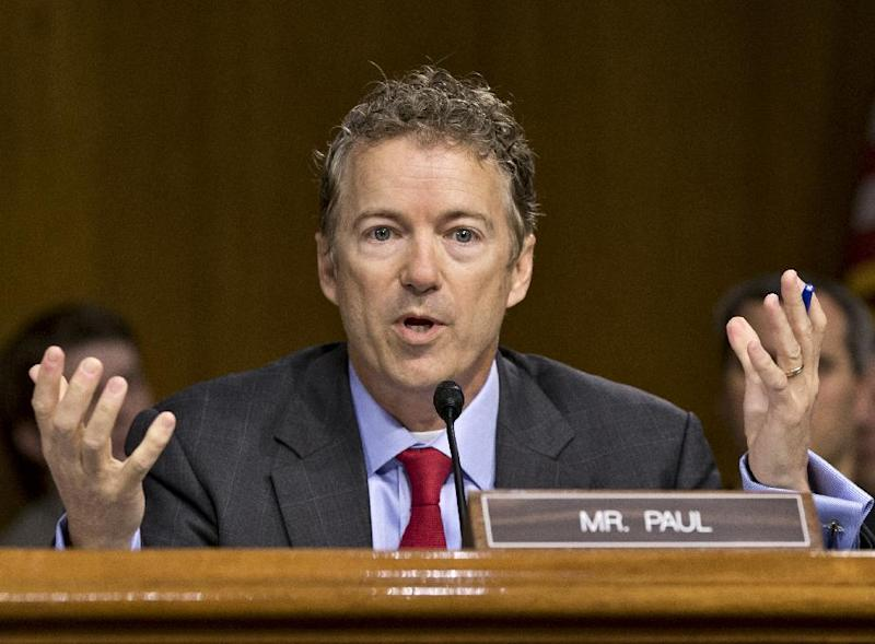 In this May 21, 2013, photo, Sen. Rand Paul, R-Ky., expresses his displeasure that Apple CEO Tim Cook was being brought before the Senate Homeland Security and Governmental Affairs Permanent Subcommittee as the panel examines the methods employed by multinational corporations to shift profits offshore and how such activities are affected by the Internal Revenue Code, on Capitol Hill in Washington. A long-simmering feud in the Senate between establishment Republicans and tea partyers breaks into full view, with Sen. John McCain accusing younger colleagues of overplaying their hands and tempting Democrats to change Senate rules that protect the minority party. How to deal with the budget and debt become the latest quarrel in a string of them between McCain _ sometimes joined by other traditionalist Republicans _ and brash, tea party-champions such as Ted Cruz of Texas, Paul and Mike Lee of Utah. (AP Photo/J. Scott Applewhite, File)