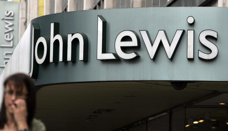 The John Lewis department store and sign on its Oxford Street flagship store in London, Wednesday Aug. 13, 2008. (AP Photo/Alastair Grant)