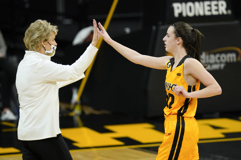 "Iowa guard Caitlin Clark, right, celebrates with coach Lisa Bluder during the first half of the team's NCAA college basketball game against Ohio State, Wednesday, Jan. 13, 2021, in Iowa City, Iowa. Clark is fourth in the nation in scoring, fourth in the nation in assists and ninth in assists per game. She is also second on the team in rebounds and tied for the team lead in blocked shots. ""She's not one-dimensional,"" Bluder said. (AP Photo/Charlie Neibergall)"