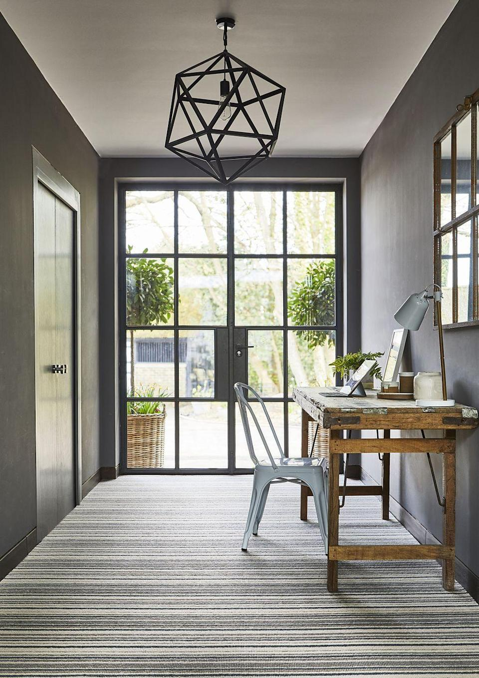 """<p>Patterned carpets are a very efficient way to alter perspectives in your home, adding the allusion of extra depth or space. Here, a horizontal stripe is used to widen a narrow room, and create a visual tunnel towards some lovely garden views. </p><p>Pictured: <a href=""""https://www.carpetright.co.uk/carpets/residence-striped-carpet/"""" rel=""""nofollow noopener"""" target=""""_blank"""" data-ylk=""""slk:Residence Striped Carpet at Carpetright"""" class=""""link rapid-noclick-resp"""">Residence Striped Carpet at Carpetright</a></p>"""