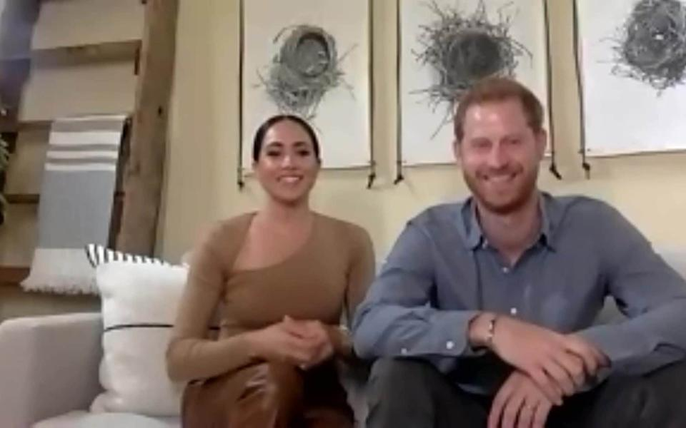 Meghan wearing leather trousers in a recent video inteview - PA
