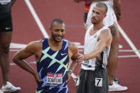 Garrett Scantling, left, reacts to his win in the the decathlon after 1500-meter run with third place, Zach Ziemek at the U.S. Olympic Track and Field Trials Sunday, June 20, 2021, in Eugene, Ore. (AP Photo/Chris Carlson)