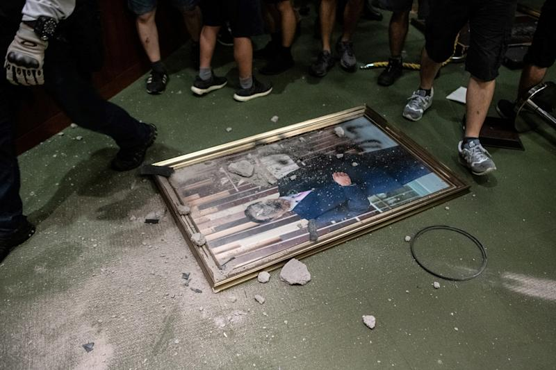 The portrait of chairman of the Legislative Council Andrew Leung is destroyed after protesters broke into the parliament chamber of the government headquarters in Hong Kong on July 1, 2019. (Photo: Philip Fong/AFP/Getty Images)