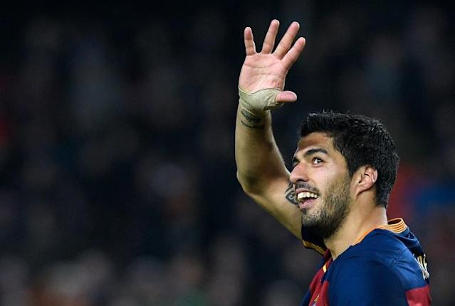 Barcelona's forward Luis Suarez celebrates a goal during the Spanish Copa del Rey (King's Cup) football match FC Barcelona vs Valencia CF at the Camp Nou stadium in Barcelona on February 3, 2016