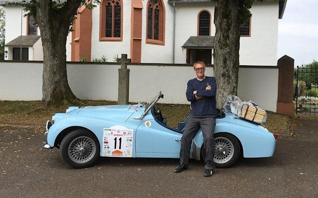 English with his 1960 Triumph TR3a just before the start of the Liège-Brescia-Liège road rally