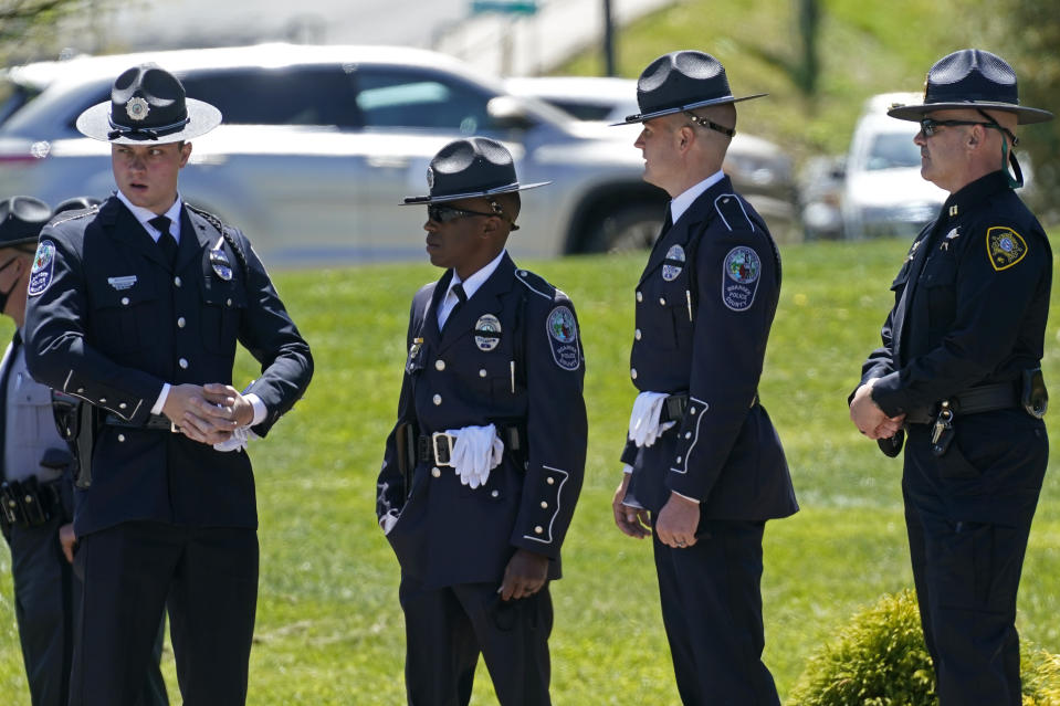 Law enforcement officer gather outside the Holmes Convocational Center for the funeral services of Watauga County Sheriff's Deputies Sgt. Chris Ward and K-9 Deputy Logan Fox in Boone, N.C., Thursday, May 6, 2021. The two deputies were killed in the line of duty. (AP Photo/Gerry Broome)
