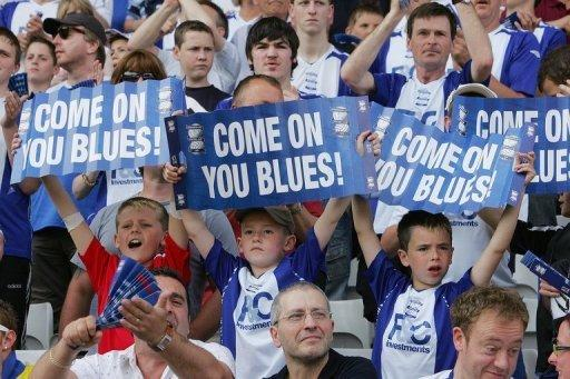 File photo of Birmingham City fans at St Andrew's stadium. Tycoon Carson Yeung, facing trial in Hong Kong on money-laundering charges, has assured Birmingham City he will continue to support the club financially despite his legal problems