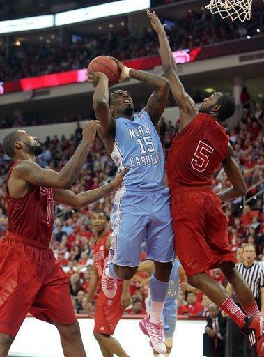 North Carolina's P.J. Hairston (15) drives to the basket between North Carolina State's Richard Howell, left, and C.J. Leslie (5) during the first half of an NCAA college basketball game in Raleigh, N.C., Saturday, Jan. 26, 2013. (AP Photo/Ted Richardson)